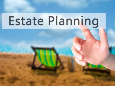 Estate Planning - Hand pressing a button on blurred background c