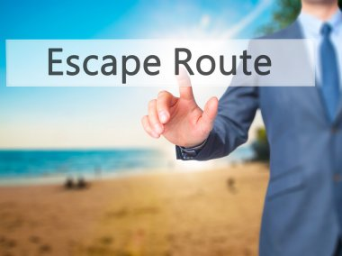 Escape Route - Businessman hand pressing button on touch screen