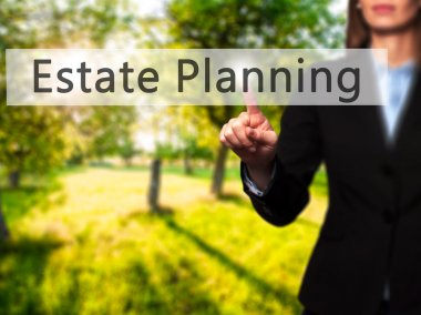Estate Planning - Businesswoman hand pressing button on touch sc