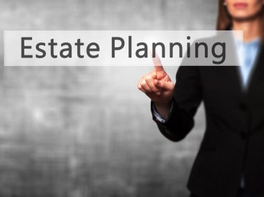 Estate Planning - Businesswoman hand pressing button on touch sc