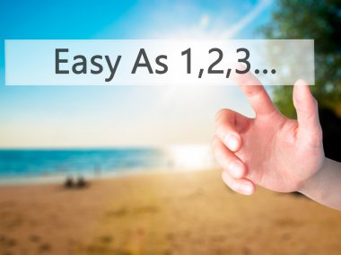 Easy As 1,2,3... - Hand pressing a button on blurred background