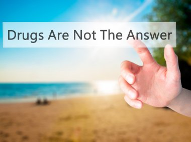 Drugs Are Not The Answer - Hand pressing a button on blurred bac
