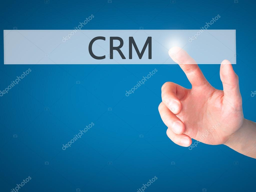 Crm Hand Pressing A Button On Blurred Background Concept On Vi