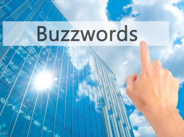 Buzzwords - Hand pressing a button on blurred background concept