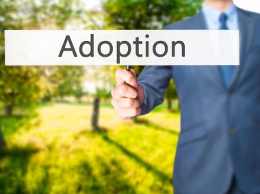 Adoption - Businessman hand holding sign