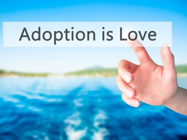 Adoption is Love - Hand pressing a button on blurred background