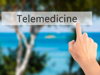 Telemedicine - Hand pressing a button on blurred background conc