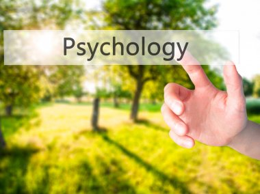 Psychology - Hand pressing a button on blurred background concep