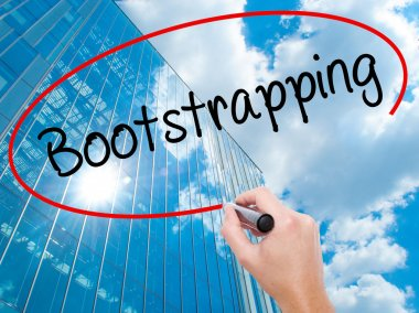 Man Hand writing Bootstrapping with black marker on visual scree