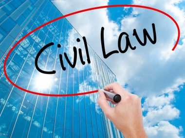 Man Hand writing Civil Law with black marker on visual screen