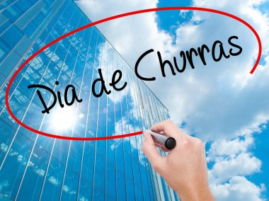 Man Hand writing Dia de Churras (Barbecue Day In Portuguese) wit