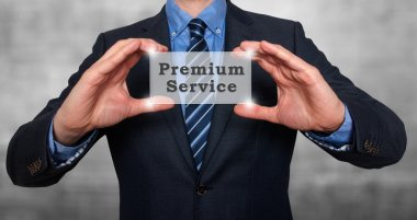 Businessman holds  premium service in his hands. stock image