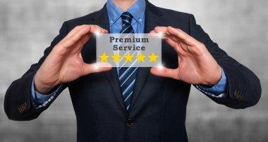 Businessman holds five stars premium service. stock image