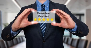 Businessman holds five stars premium service. stock image