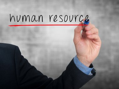 Businessman hand writing Human Resource in the air  - Stock Image