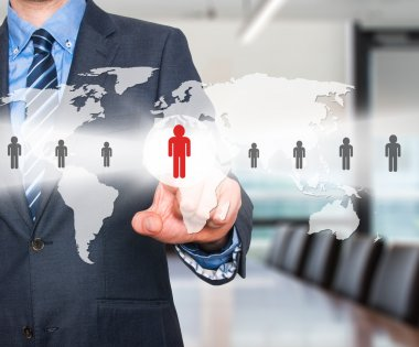 Businessman touching human resources sign - HR, HRM, HRD concept. World Map. Stock Image