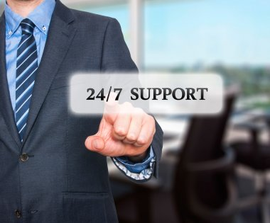 Businessman pointing at all day support  services. Internet online support business concept. Stock Image