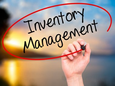 Man Hand writing Inventory Management with black marker on visua