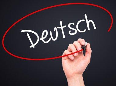 Man Hand writing Deutsh (German in German) with black marker on