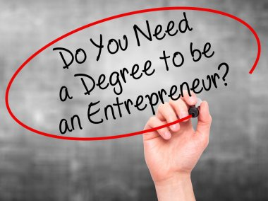 Man Hand writing Do You Need a Degree to be an Entrepreneur? wit