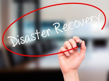 Man Hand writing Disaster Recovery with black marker on visual s