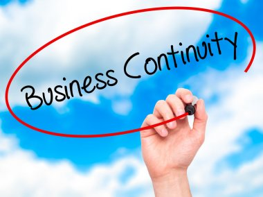 Man Hand writing Business Continuity with black marker on visual
