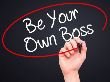 Man Hand writing Be Your Own Boss with black marker on visual sc