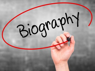 Man Hand writing Biography  with black marker on visual screen