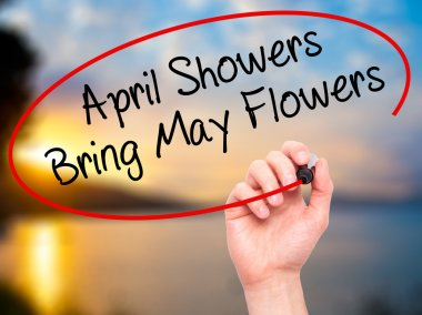 Man Hand writing April Showers Bring May Flowers with black mark
