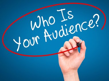 Man Hand writing Who Is Your Audience? with black marker on visu
