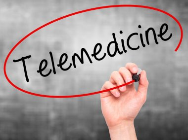 Man Hand writing Telemedicine with black marker on visual screen
