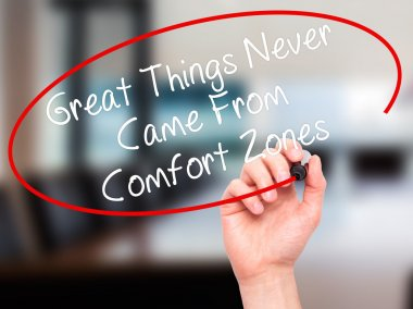 Man Hand writing Great Things Never Came From Comfort Zones with