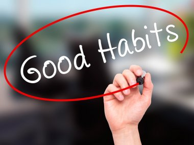Man Hand writing Good Habits with black marker on visual screen