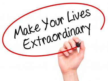 Man Hand writing Make Your Lives Extraordinary with black marker