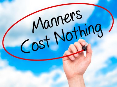 Man Hand writing Manners Cost Nothing with black marker on visua