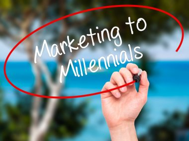 Man Hand writing Marketing to Millennials with black marker on v