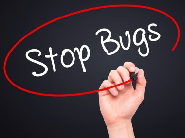 Man Hand writing Stop Bugs with black marker on visual screen