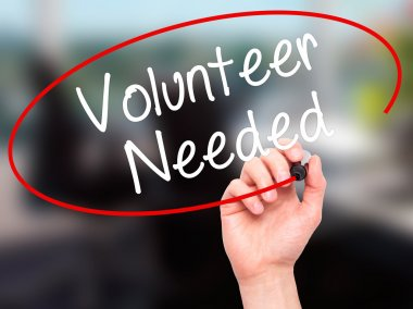 Man Hand writing Volunteer Needed with black marker on visual sc
