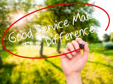Man Hand writing Good Service Makes The Difference with black ma