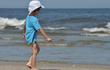 Holiday at the sea. Family with children on the beach. Sea and lake. Tourism and leisure