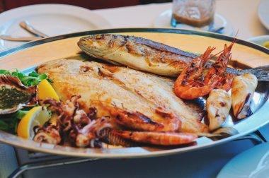 mixed fish and sea food served