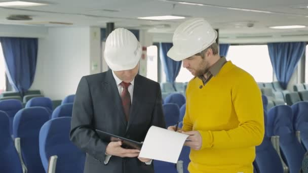 Business partners discuss a new project inside the ferry