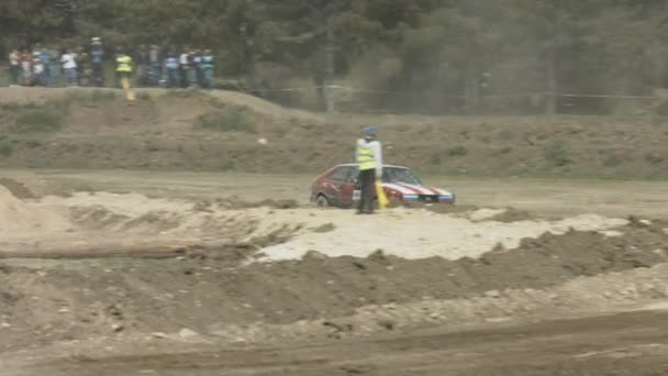 Red Racing Car Passes a Turn at High Speed in the Rally on a Dusty Road. Motorsport Cross-Country