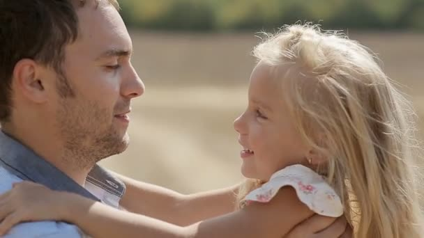 Dad and little daughter hugging and kissing each other in slow motion