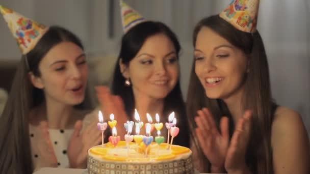 Pretty girls with birthday cake