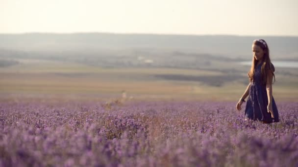 Girl walks in lavender field
