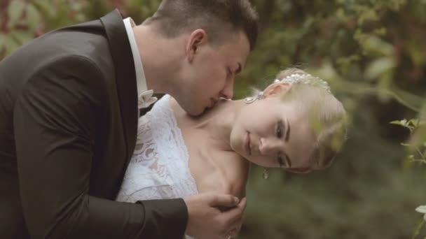 Groom tips bride and kisses her on the neck