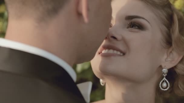Close-up of bride and groom in love
