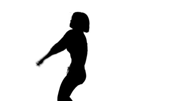 Černá silueta tanečnice na bílém pozadí