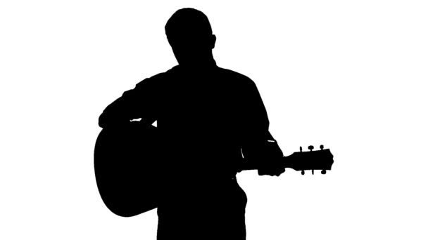 Black silhouette of guy playing guitar on a white background